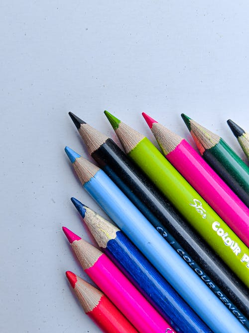 Macro Shot of Color Pencils on a White Surface