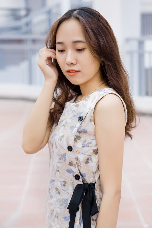 Girl in White and Blue Floral Sleeveless Dress