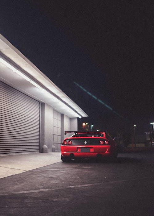 Red Car Parked in Garage
