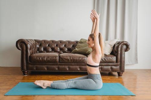 Content woman doing yoga asana