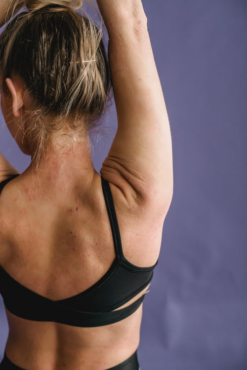 Graceful fit woman demonstrating strong back