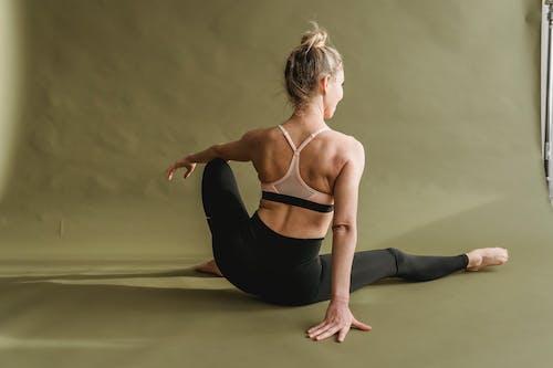 Flexible woman doing yoga in studio