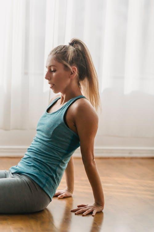 Fit woman practicing yoga in Dandasana pose