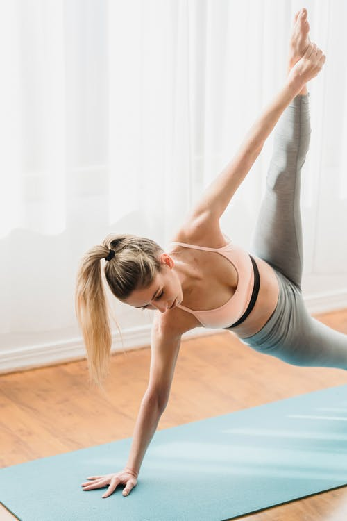 Woman in Plank Extended Side pose