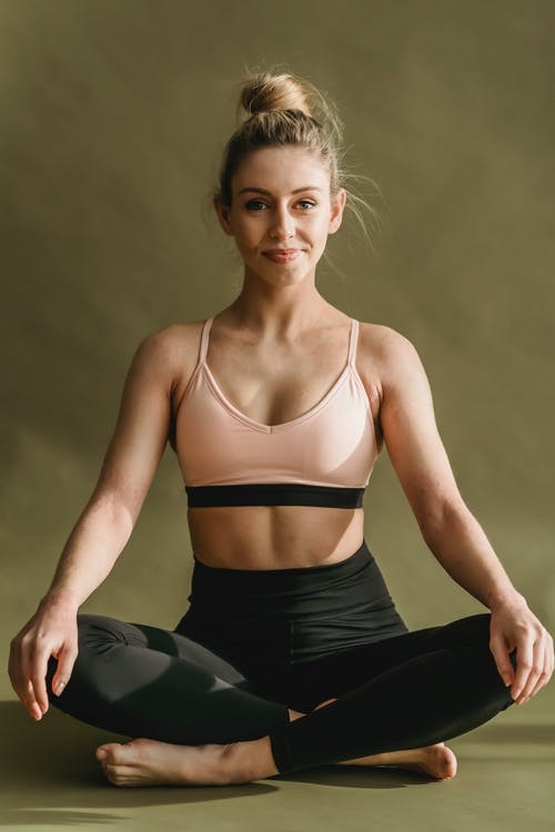 Fit woman practicing Easy Sit posture