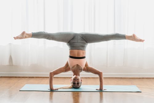 Woman in Gray Leggings Doing Yoga