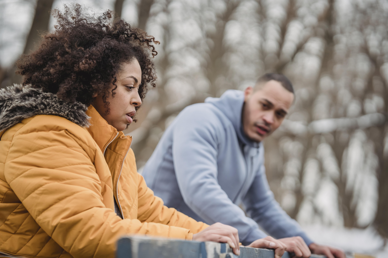black couple training on winter street