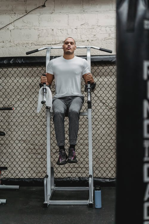 Full body of serious African American sportsman doing abdomen exercises for strengthen muscles in gym