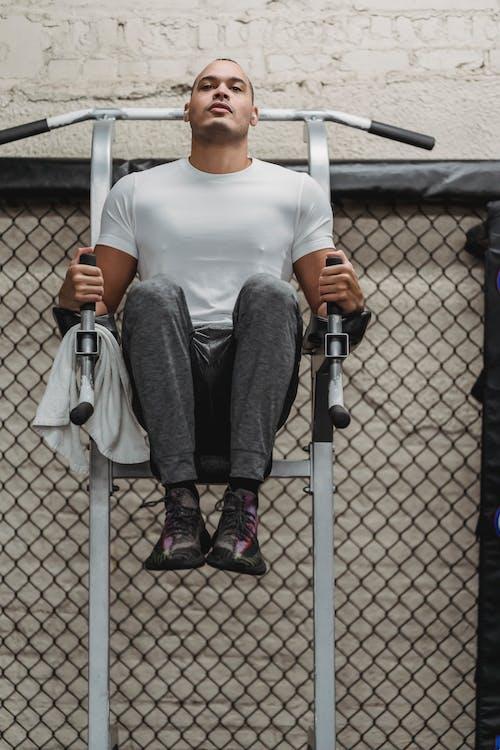 Black sportsman doing abs exercise