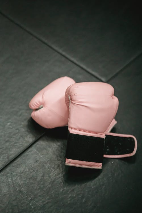 Boxing gloves on sports mat in gym