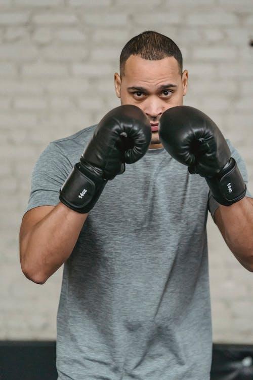 Ethnic boxer showing defense technique during workout