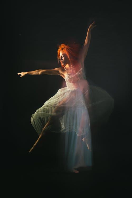 Woman in White Dress Dancing
