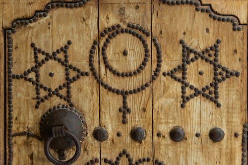 Religious symbols on wooden door