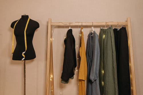 Hanging Clothes on Wooden Rack