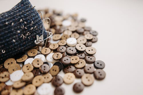 Close Up Photo of Wooden Buttons