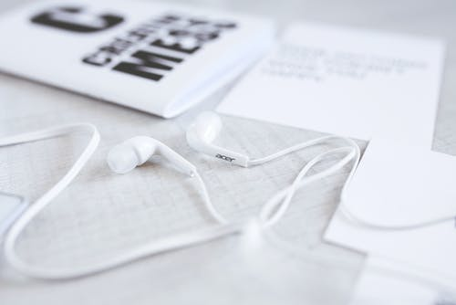 White and modern earphones on a desk