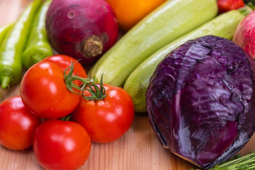 Close-Up Shot of Fresh Vegetables on a Wooden Table