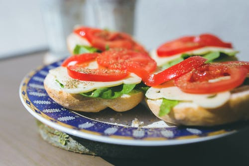 Sandwiches with cheese, lettuce and tomato on a plate