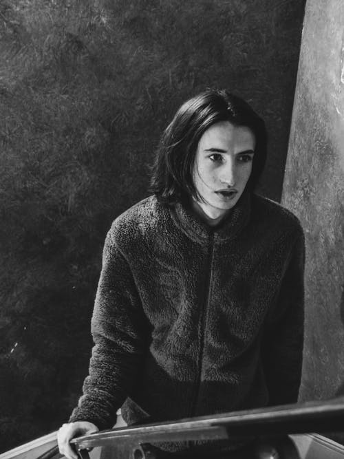 Grayscale Photo of a Handsome Man with Long Hair