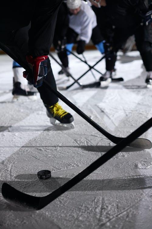 Close-Up Photo of People Playing Ice Hockey