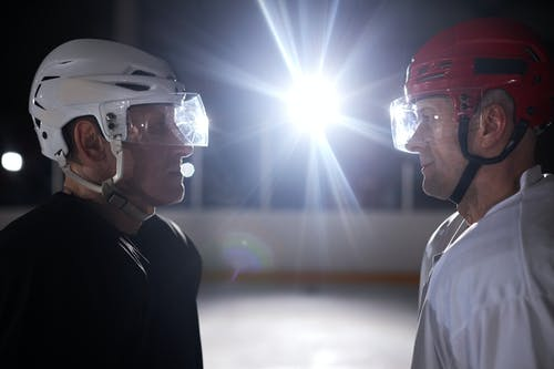 Two Competitive Ice Hockey Players Looking at Each Other