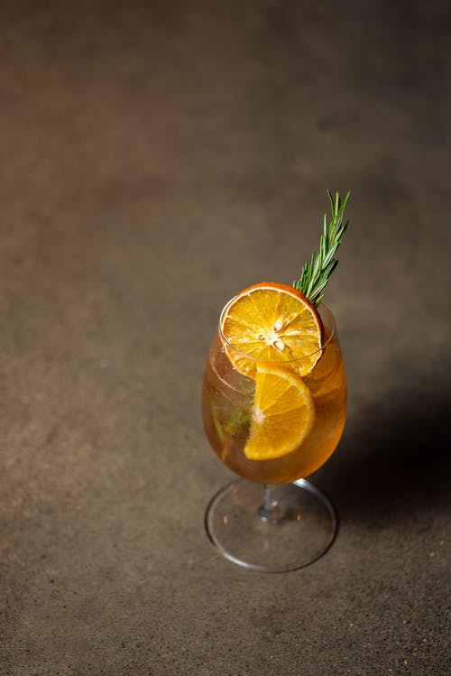 Orange Fruit on Clear Glass Cup