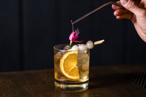 Whisky with Cocktail Onions and Edible Flower