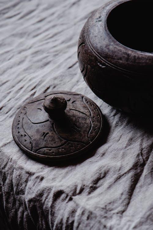 Black Ceramic Bowl on Gray Textile