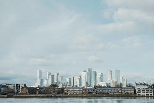 City Skyline Under White Clouds