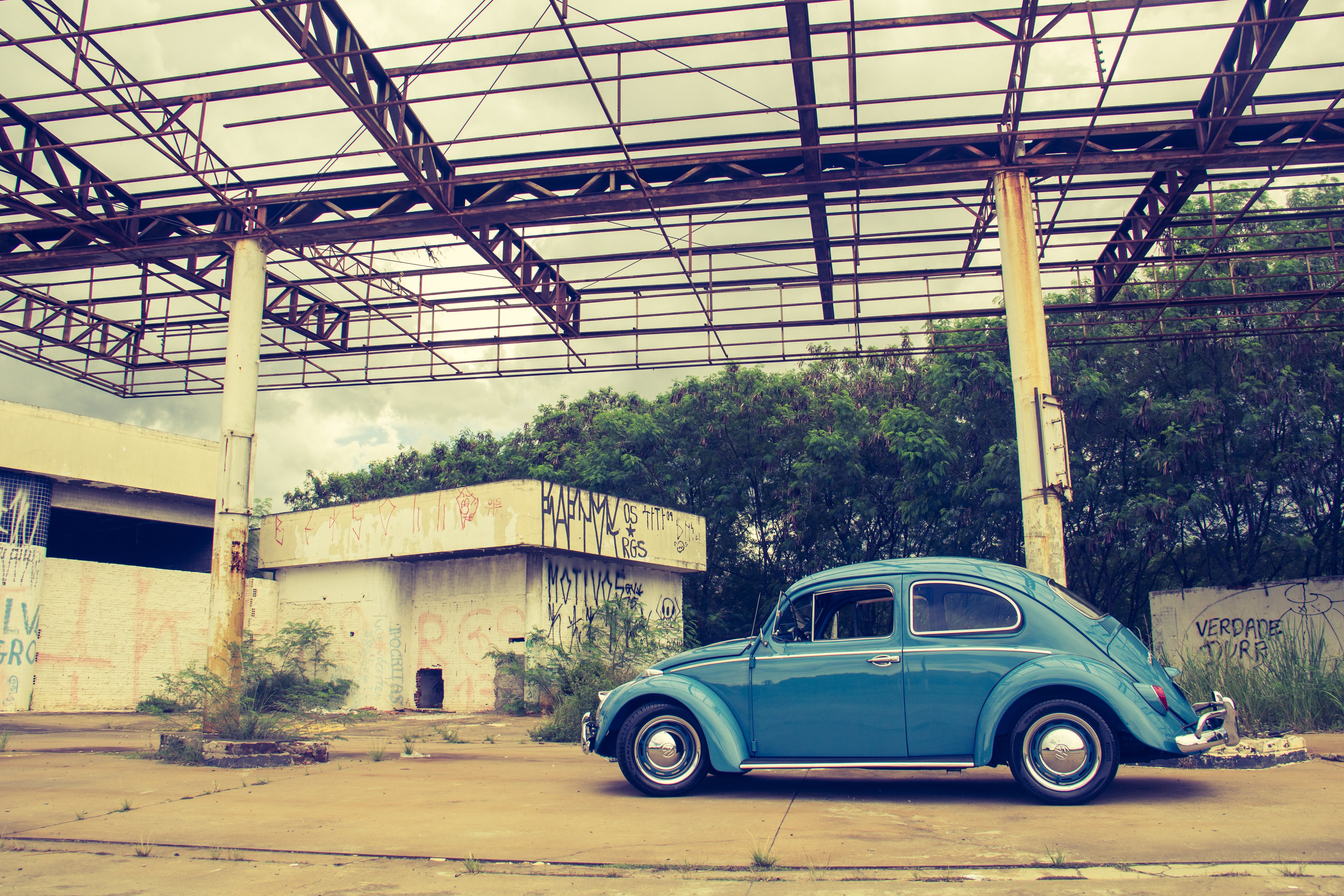 Blue Volkswagen Beetle in Front of Building