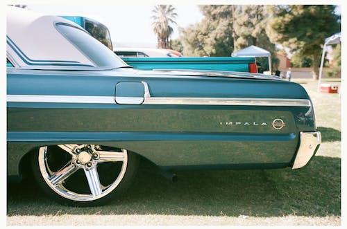 Blue Impala SS Chevrolet on Road
