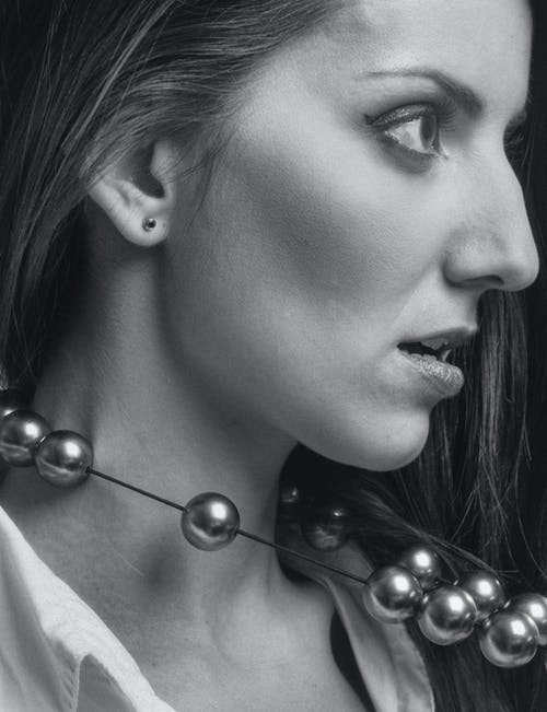 Woman Wearing Silver Stud Earrings