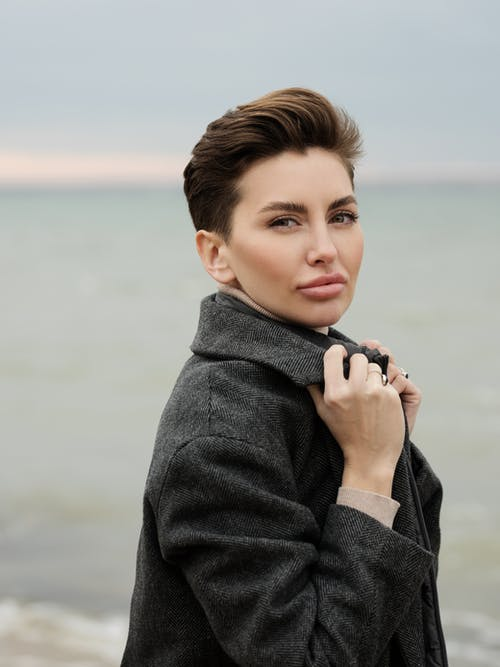 Woman in Gray Coat Holding Her Chin