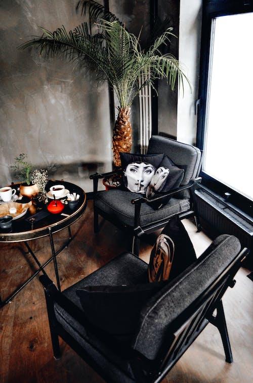 Black and White Sofa Chair Near Window