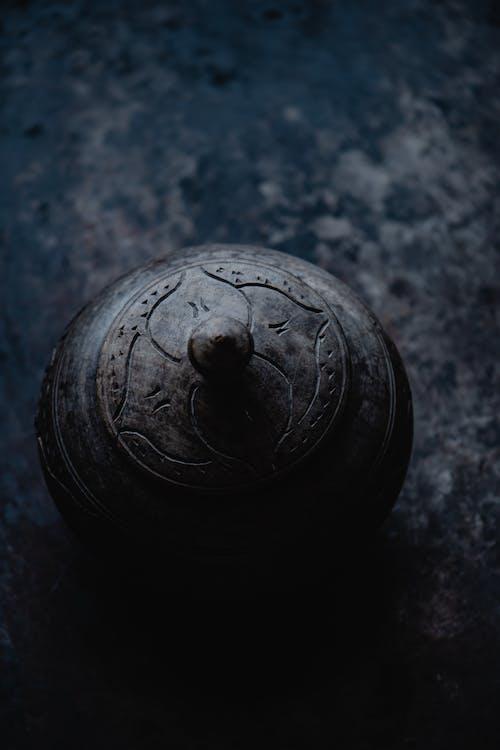 Black Round Ball on Black Surface