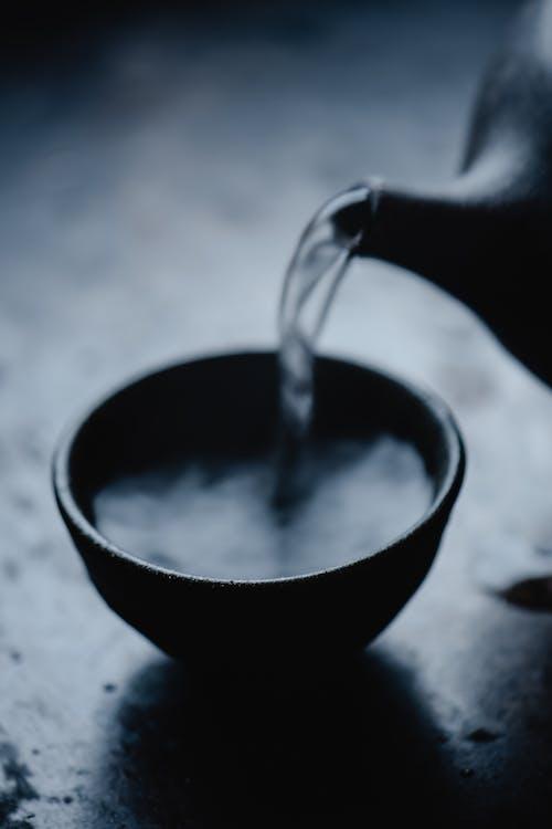 Black Ceramic Bowl With Silver Spoon