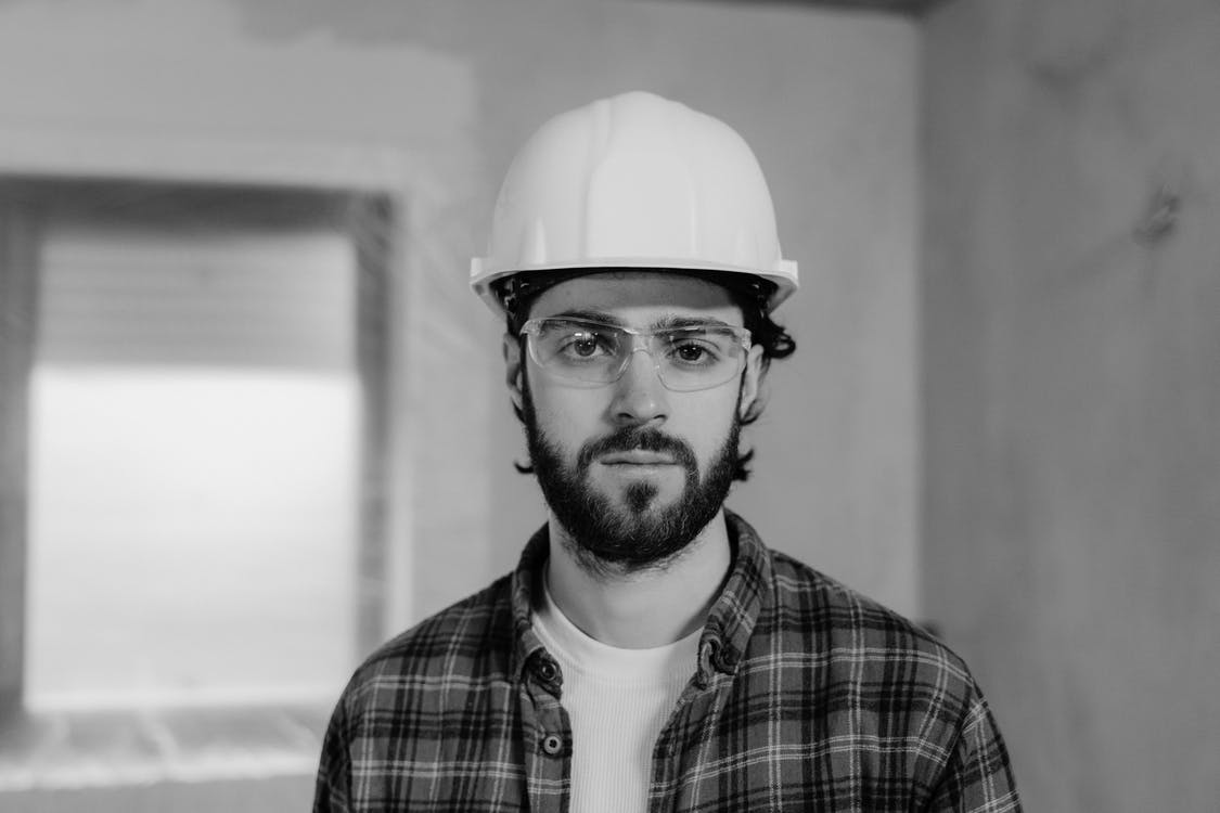 Man in White Hard Hat and Plaid Shirt