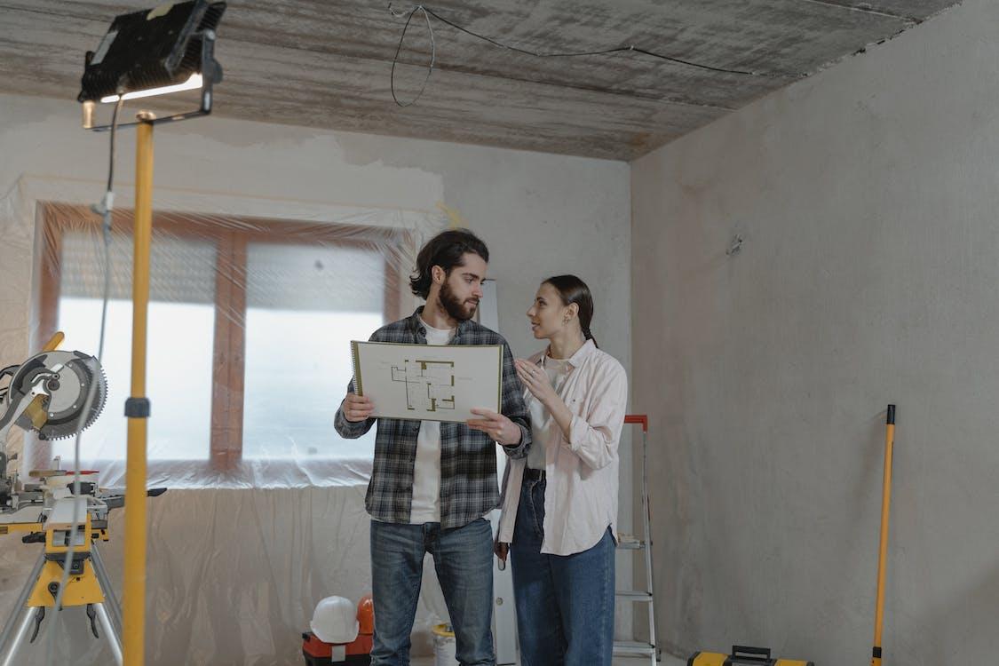 Couple Holding a Blueprint