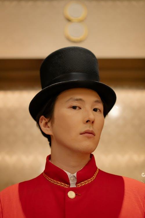 Boy in Red Shirt Wearing Black Hat