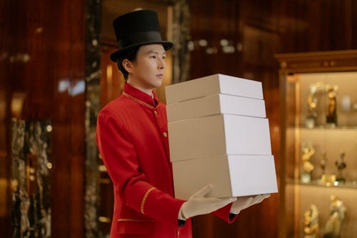 Man Carrying White Boxes
