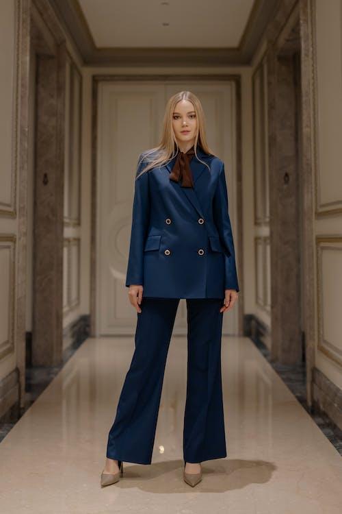 Woman in Blue Pant Suit
