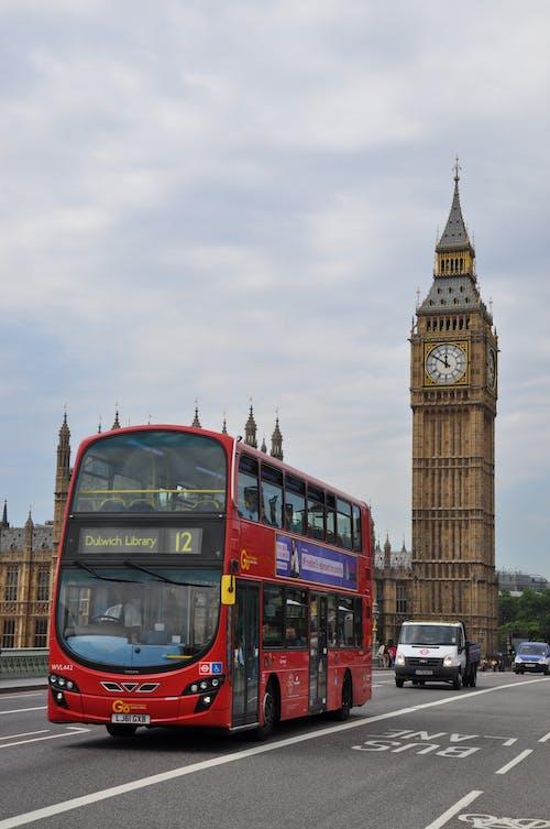 Red Double Decker Bus on Road Near Big Ben