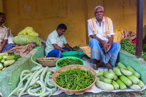 Men Selling Fresh Vegetables