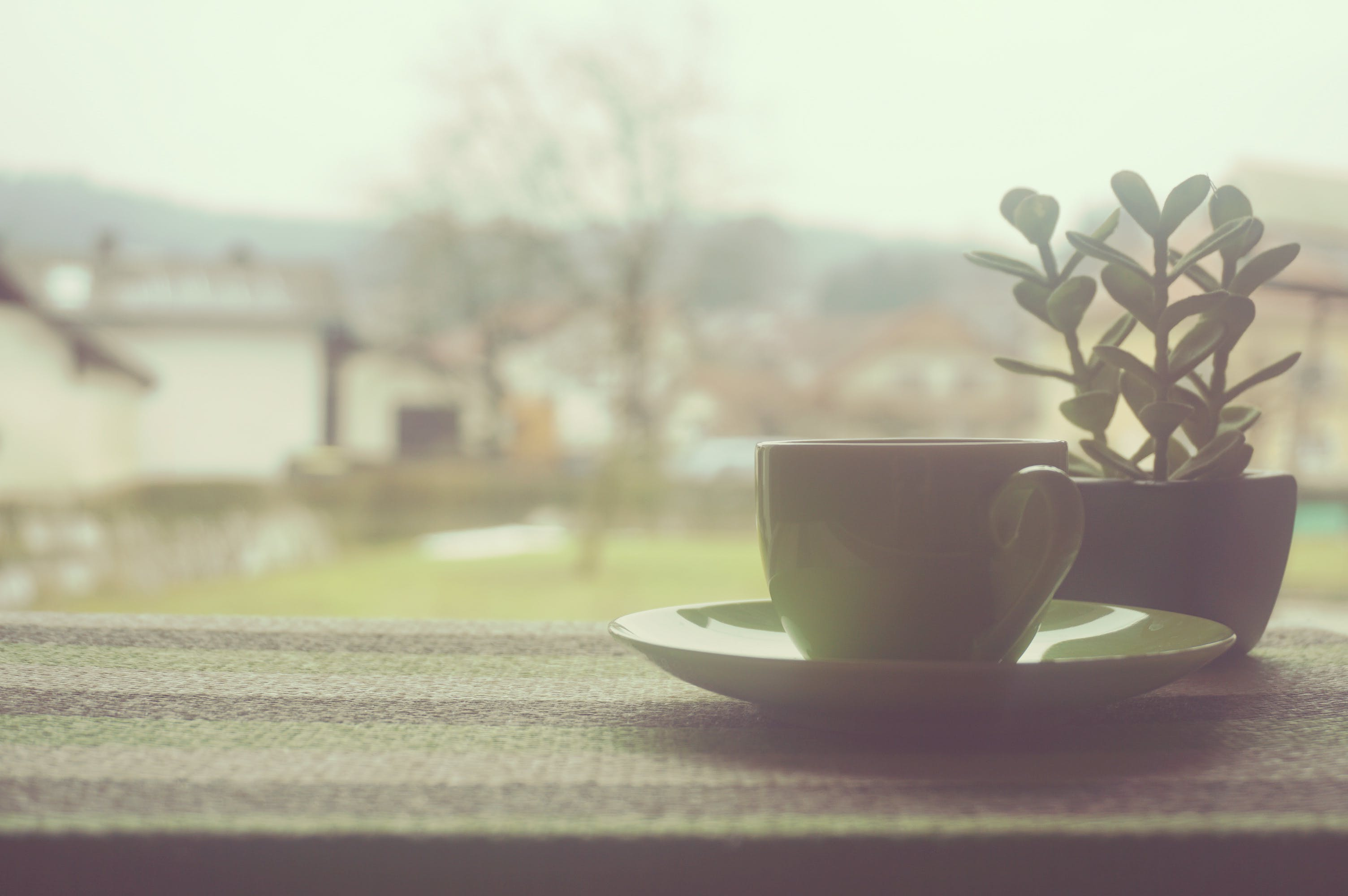 Yellow Teacup on Balcony Wall