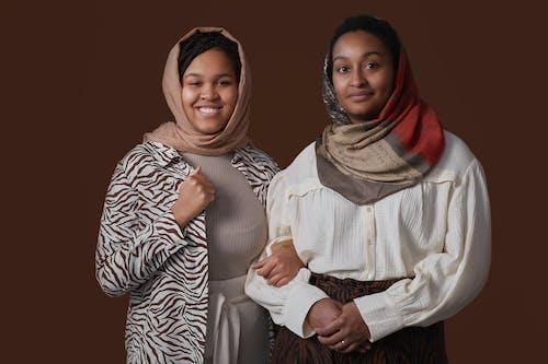 2 Women Wearing Hijab Smiling
