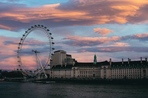 Photo of London Eye Beside Riverbank During Dawn