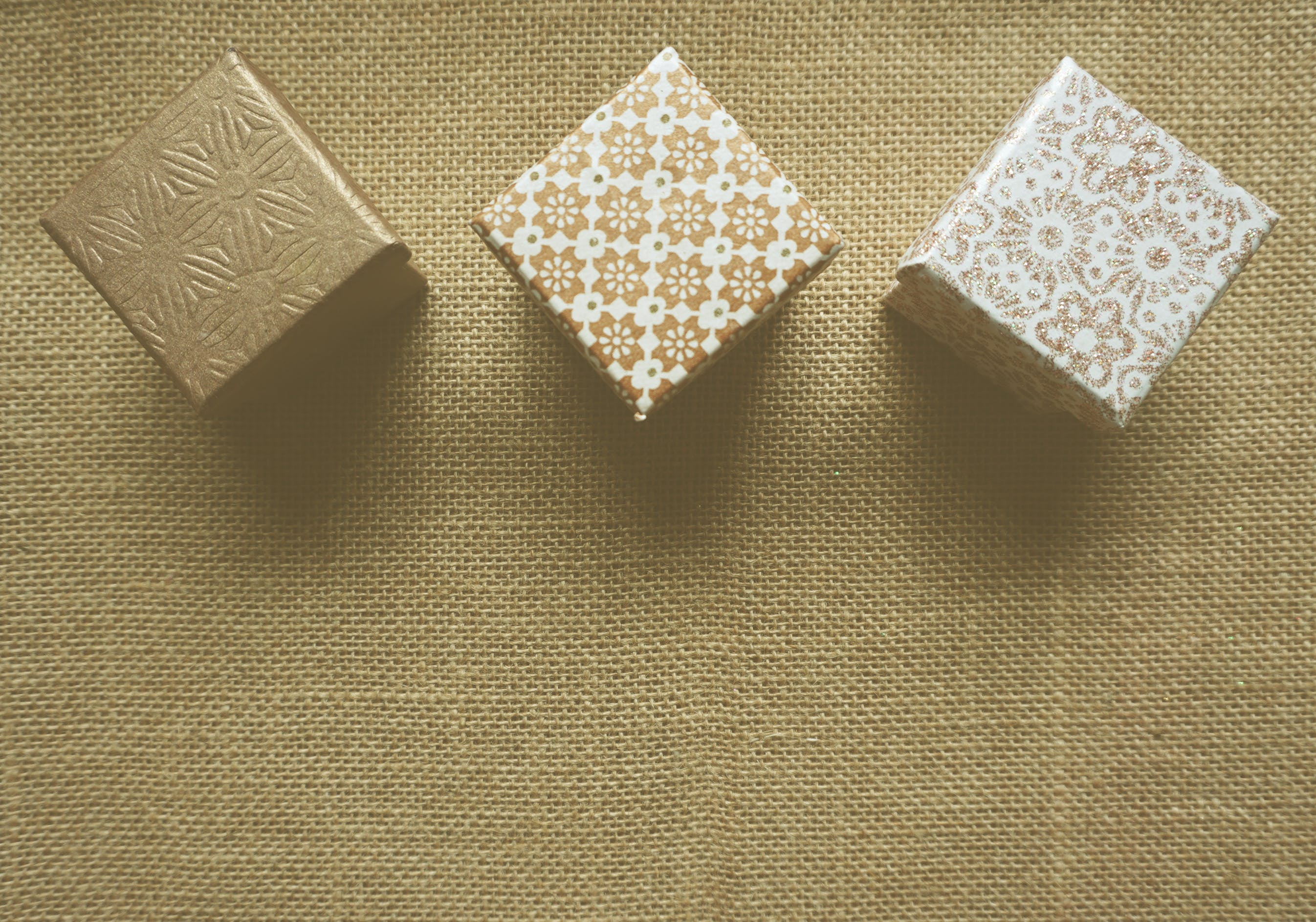 Three Brown and White Gift Boxes