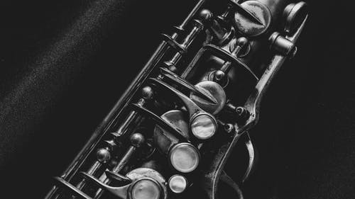 Black and Silver Trumpet on Black Textile
