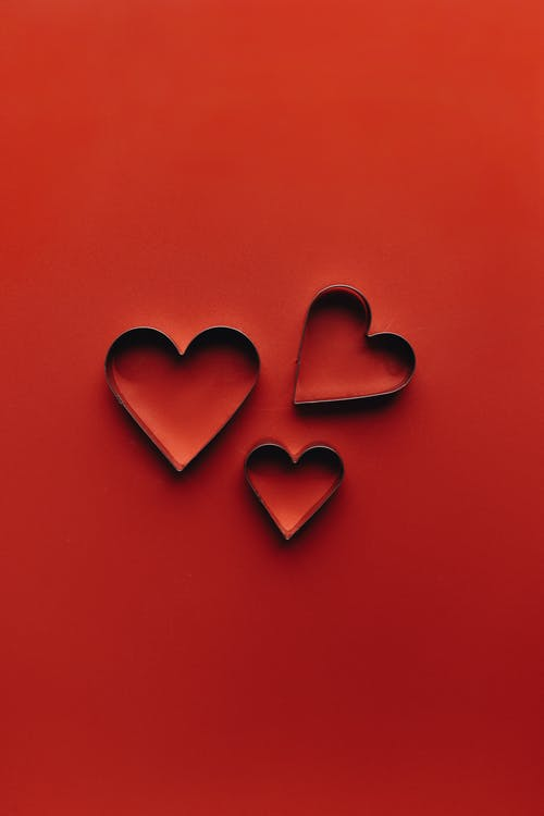 Red Hearts On Red Surface