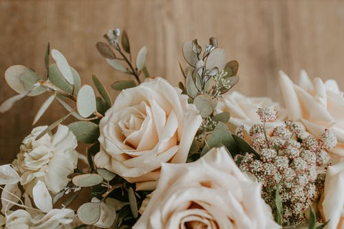 Bunch of white roses with decorative branches